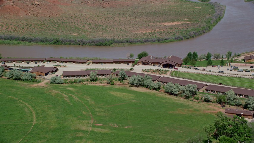 Flying by Red Cliffs Lodge and Colorado River in Moab, Utah Aerial Stock Footage | AX137_157
