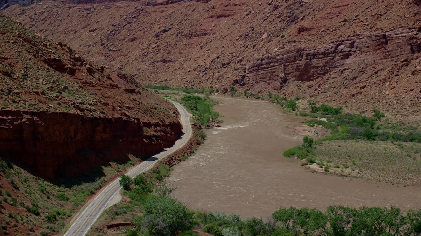 6K stock footage aerial video of State Route 128 and rapids on the Colorado River in Moab, Utah Aerial Stock Footage | AX137_158