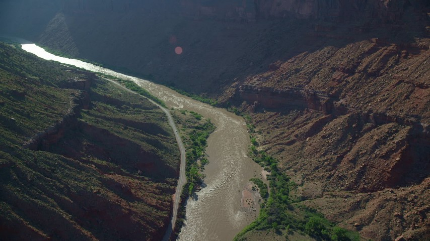 6K stock footage aerial video of following the Colorado River and State Route 128 in Moab, Utah Aerial Stock Footage | AX138_006