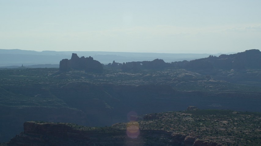 6K stock footage aerial video of desert buttes and and natural arches in Arches National Park, Utah Aerial Stock Footage | AX138_010