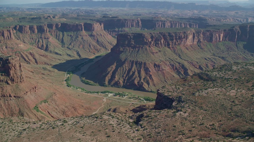 6K stock footage aerial video of a view of Big Bend Canyon and the Colorado River in Arches National Park, Utah Aerial Stock Footage | AX138_012