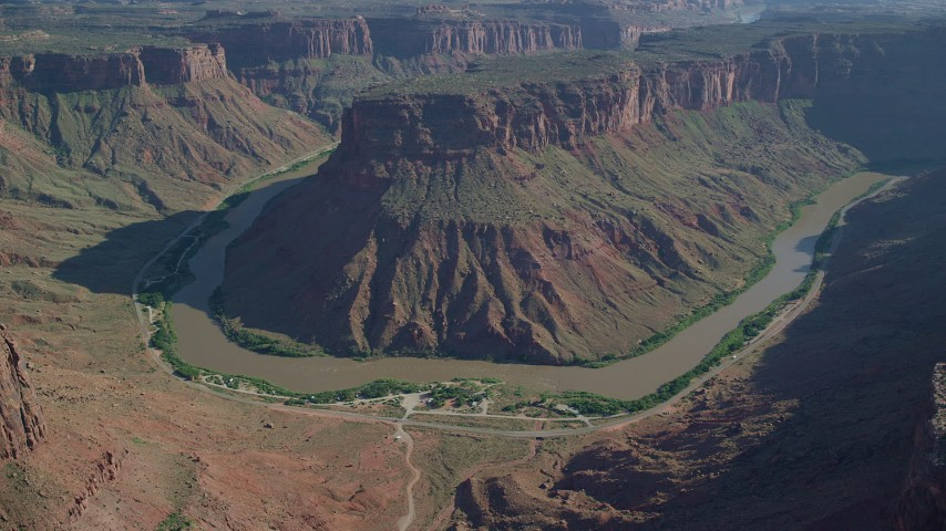 6K stock footage aerial video of flying by Big Bend Canyon and the Colorado River in Arches National Park, Utah Aerial Stock Footage | AX138_013