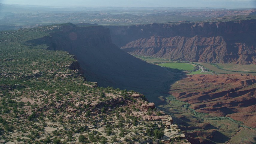 Fly by a cliff with views of Colorado River near Moab, Utah Aerial Stock Footage | AX138_020