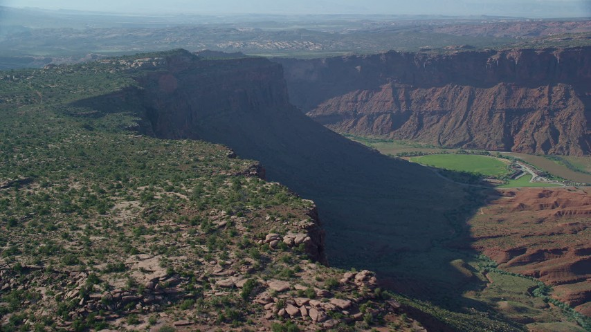 Colorado River seen from Cliffs near Moab, Utah Aerial Stock Footage | AX138_021