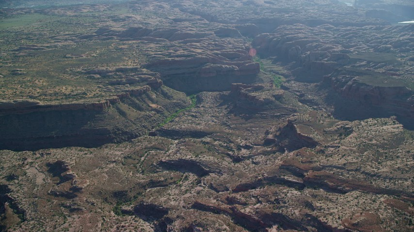 Desert canyon and rock formations, Moab, Utah Aerial Stock Footage | AX138_032