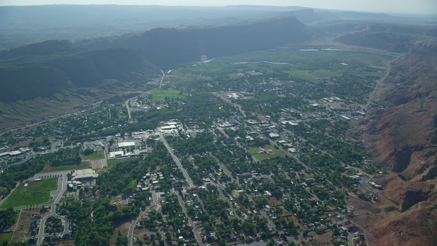 6K stock footage aerial video of a small desert town, Moab, Utah Aerial Stock Footage | AX138_040
