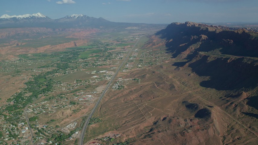 6K stock footage aerial video of a highway running through a small desert town, Moab, Utah Aerial Stock Footage | AX138_042