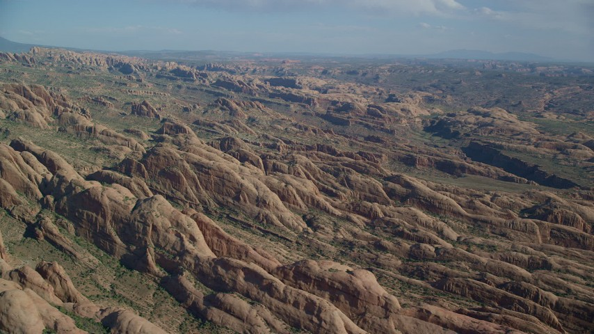 Side view of desert rock formations, Moab, Utah Aerial Stock Footage | AX138_046