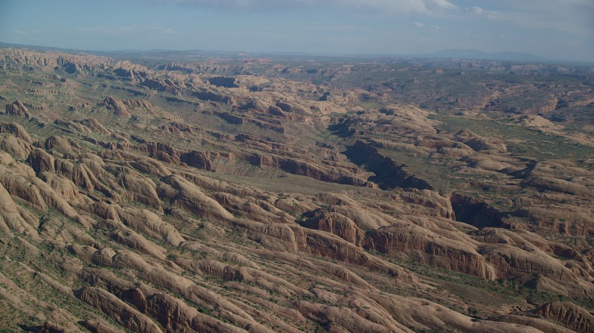 6K stock footage aerial video of desert rock formations near shallow canyon, Moab, Utah Aerial Stock Footage | AX138_047