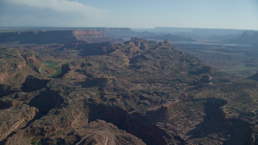 Fly over rock formations toward a canyon, Moab, Utah Aerial Stock Footage | AX138_050