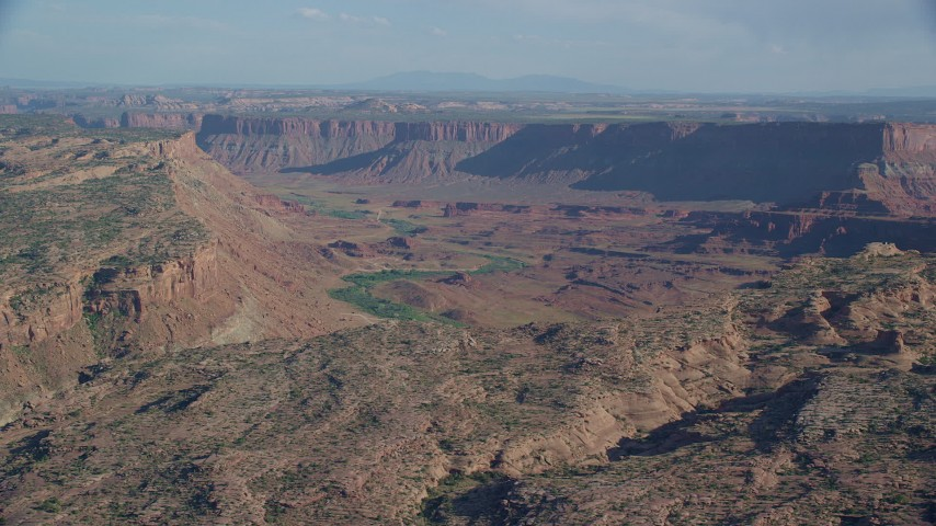 6K stock footage aerial video of a wide desert canyon and mesas, Moab, Utah Aerial Stock Footage | AX138_052