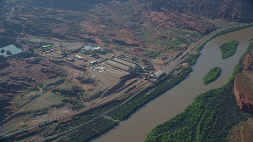 6K stock footage aerial video of Intrepid Potash factory on a bank of the Colorado River, Moab, Utah Aerial Stock Footage | AX138_056