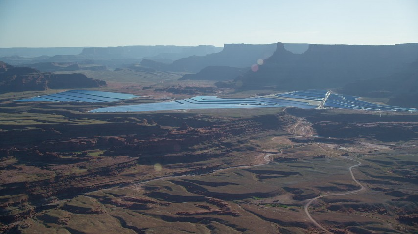 6K stock footage aerial video of passing by industrial potash ponds in the desert, Moab, Utah Aerial Stock Footage | AX138_058