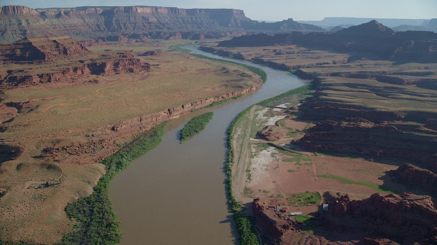 6K stock footage aerial video of flying over the Colorado River near mesas and Pyramid Butte, Moab, Utah Aerial Stock Footage | AX138_059