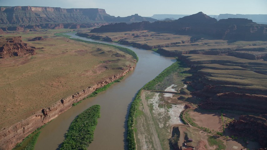 6K stock footage aerial video fly over Colorado River and approach Pyramid Butte, Moab, Utah Aerial Stock Footage | AX138_060