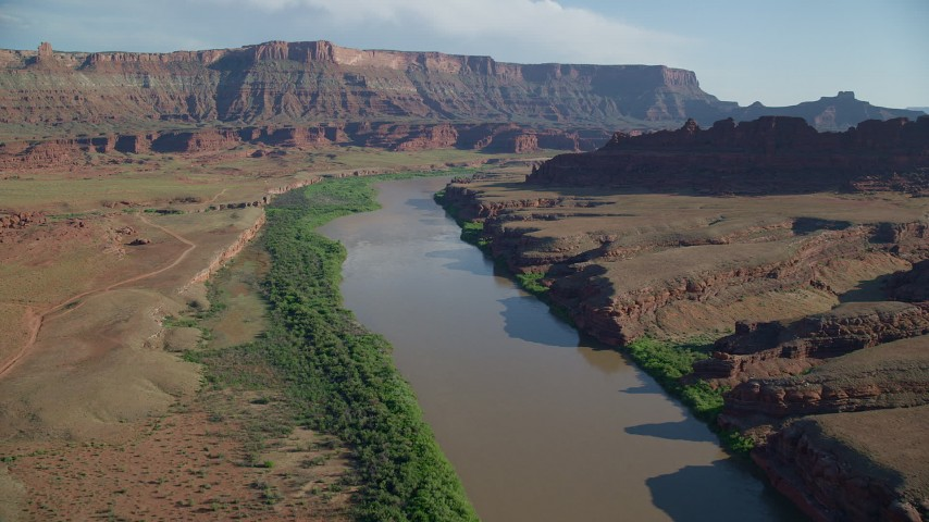 Approaching a mesa while flying over Colorado River, Moab, Utah Aerial Stock Footage | AX138_063