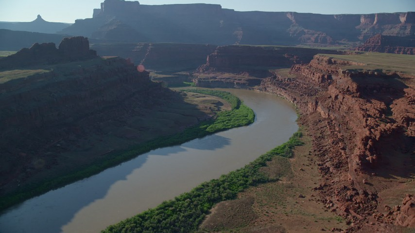 6K stock footage aerial video of the Colorado River through Meander Canyon near a butte, Moab, Utah Aerial Stock Footage | AX138_071