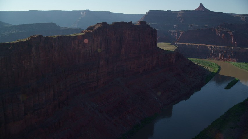 Side view of a butte while flying over Colorado River, Meander Canyon, Canyonlands National Park, Utah Aerial Stock Footage | AX138_079