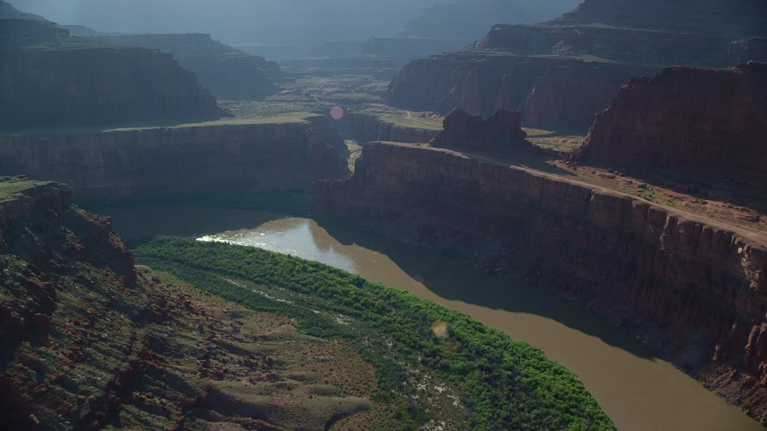 6K stock footage aerial video following Colorado River through Goose Neck in Meander Canyon, Canyonlands National Park, Utah Aerial Stock Footage | AX138_081