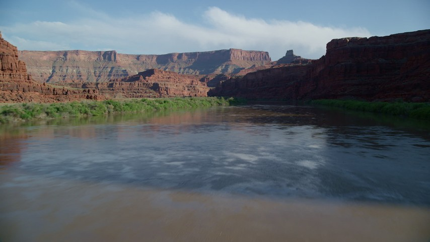 Fly Low Altitude Over Colorado River through Meander Canyon, Canyonlands National Park, Utah Aerial Stock Footage | AX138_105