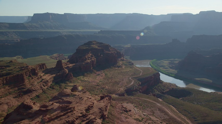 6K stock footage aerial video of passing a butte overlooking Meander Canyon and Colorado River, Canyonlands National Park, Utah Aerial Stock Footage | AX138_113