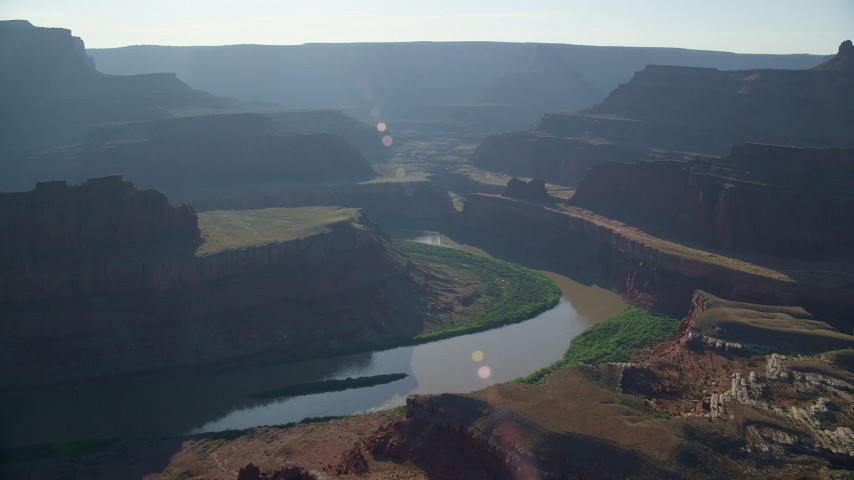 6K stock footage aerial video fly over Colorado River in Meander Canyon, approach Shafer Canyon, Canyonlands National Park, Utah Aerial Stock Footage | AX138_114
