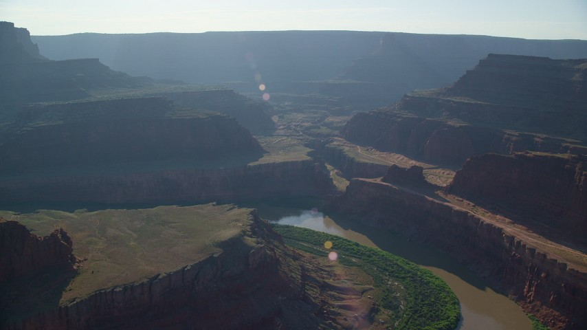 6K stock footage aerial video pass over the Colorado River and Meander Canyon to approach Shafer Canyon, Canyonlands National Park, Utah Aerial Stock Footage | AX138_115