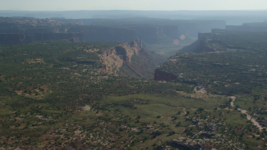 6K stock footage aerial video of approaching the rim of Taylor Canyon in Canyonlands National Park, Utah Aerial Stock Footage | AX138_132