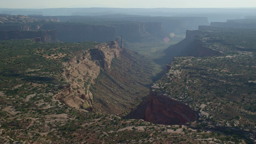 Approach Taylor Canyon and Zeus and Moses Butte in Canyonlands National Park, Utah Aerial Stock Footage | AX138_133