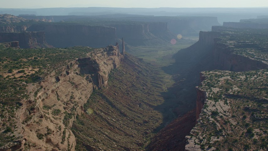 6K stock footage aerial video fly over Taylor Canyon to approach Zeus and Moses Butte, Canyonlands National Park, Utah Aerial Stock Footage | AX138_134