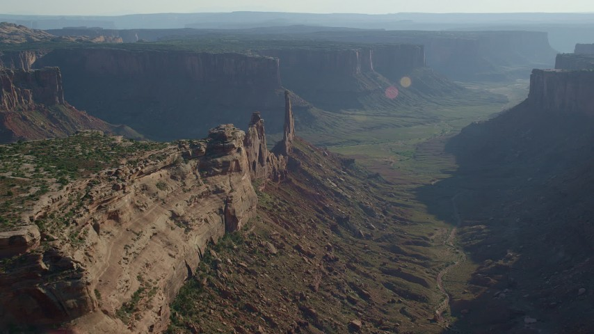 6K stock footage aerial video flying over Taylor Canyon to approach the Zeus and Moses Butte in Canyonlands National Park, Utah Aerial Stock Footage | AX138_135