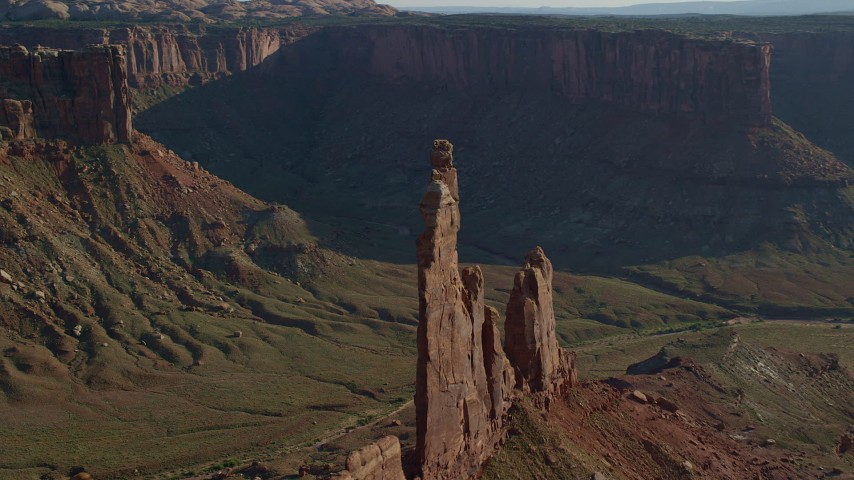 Flyby Zeus and Moses Butte in Taylor Canyon, Canyonlands National Park, Utah Aerial Stock Footage   AX138_137