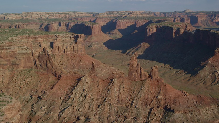 Zeus and Moses Butte in Taylor Canyon, Canyonlands National Park, Utah Aerial Stock Footage AX138_140