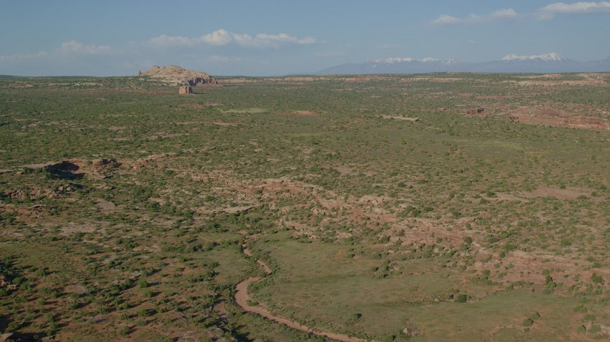 Flying Over the Open Desert in Canyonlands National Park, Utah Aerial Stock Footage | AX138_142