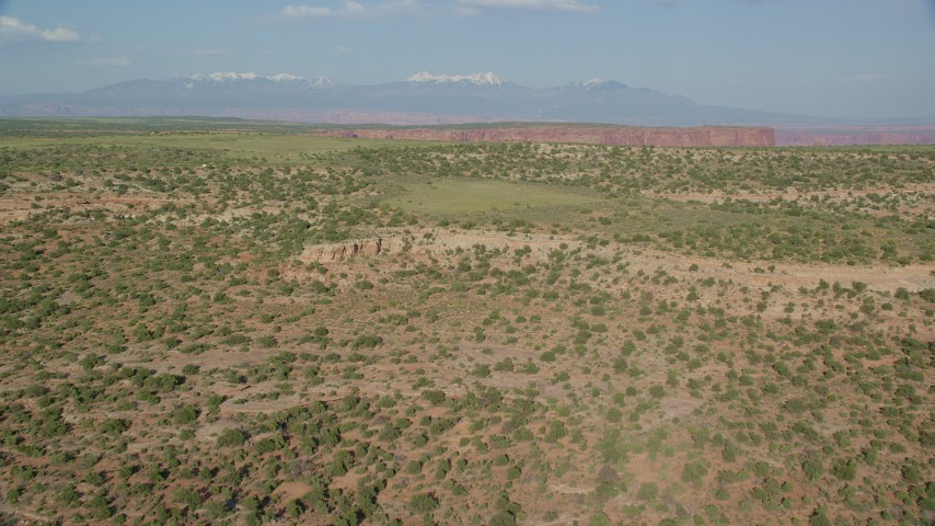 Fly Over Open Desert to Approach Shafer Canyon in Canyonlands National Park, Utah Aerial Stock Footage | AX138_146