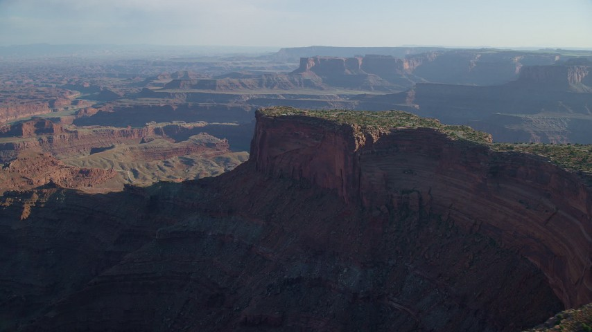Approach Dead Horse Point Overlook with a View of Canyonlands National Park, Utah Aerial Stock Footage | AX138_156
