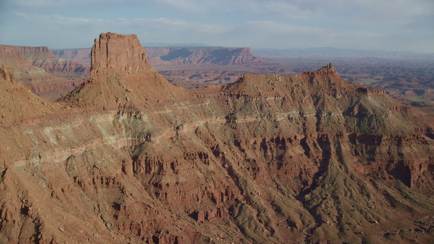 6K stock footage aerial video of flying toward the United Nations Tablet butte in Moab, Utah Aerial Stock Footage | AX138_174