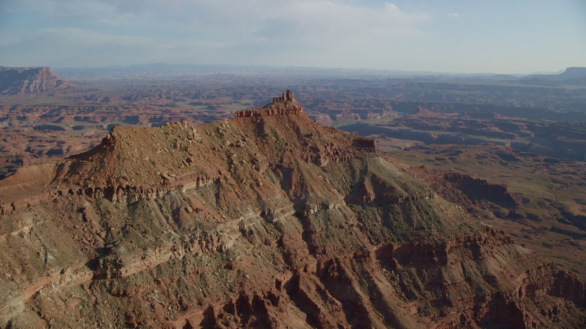 6K stock footage aerial video approach a small butte Overlooking Canyonlands National Park, Utah Aerial Stock Footage | AX138_175