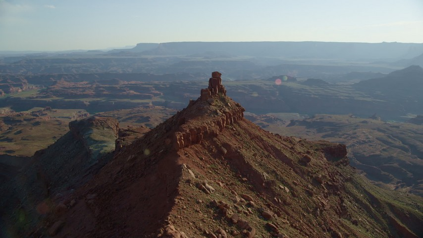 6K stock footage aerial video orbit small butte with wide view of Canyonlands National Park, Utah Aerial Stock Footage   AX138_176