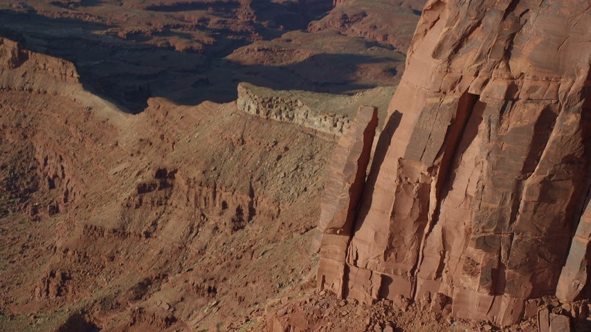 Approach and Tilt to Rock Formation on a Cliff in Moab, Utah Aerial Stock Footage | AX138_193