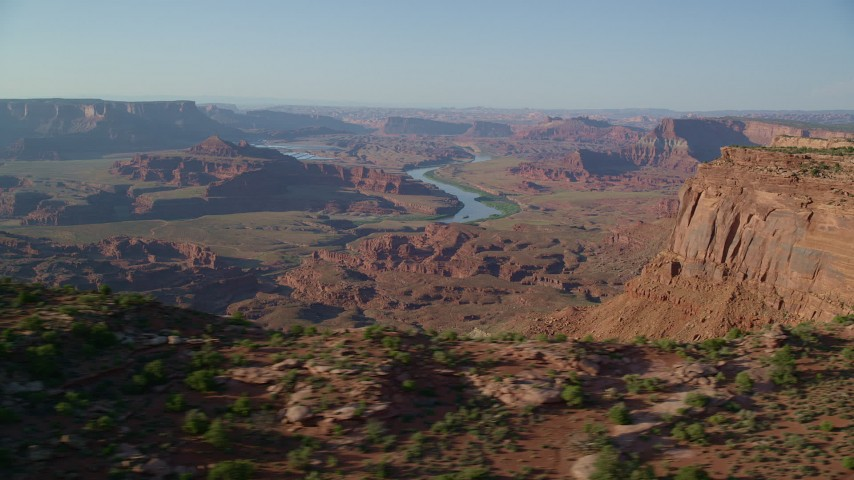 Colorado River and Desert Mesas and Buttes in Moab, Utah Aerial Stock Footage | AX138_195