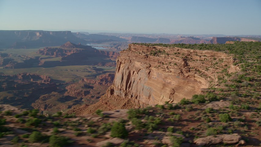 6K stock footage aerial video of a wide view of the Colorado River, buttes and mesas seen from the edge of cliffs in Moab, Utah Aerial Stock Footage | AX138_196