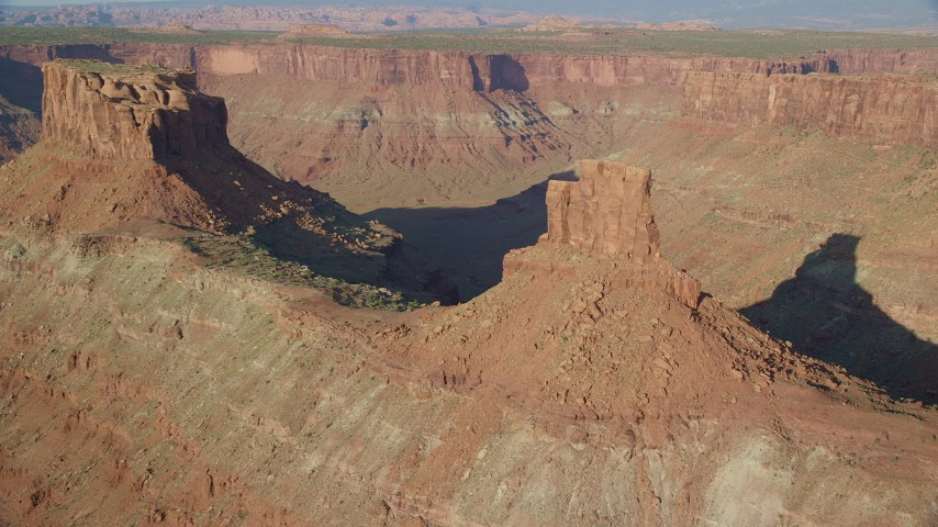 6K stock footage aerial video approach buttes above a wide canyon, Moab, Utah Aerial Stock Footage | AX138_201