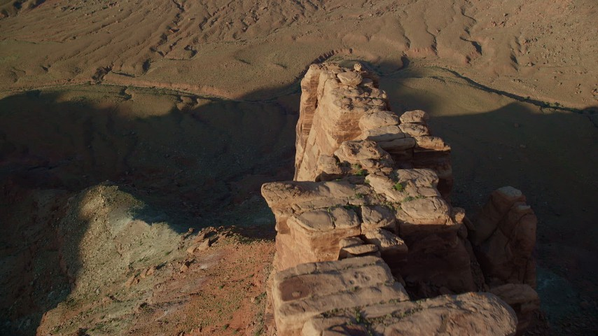 Fly Over Boulders and the Edge of a Mesa in Moab, Utah Aerial Stock Footage | AX138_205