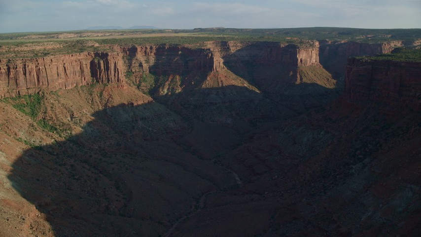 6K stock footage aerial video pan across a wide canyon in Moab, Utah Aerial Stock Footage | AX138_207