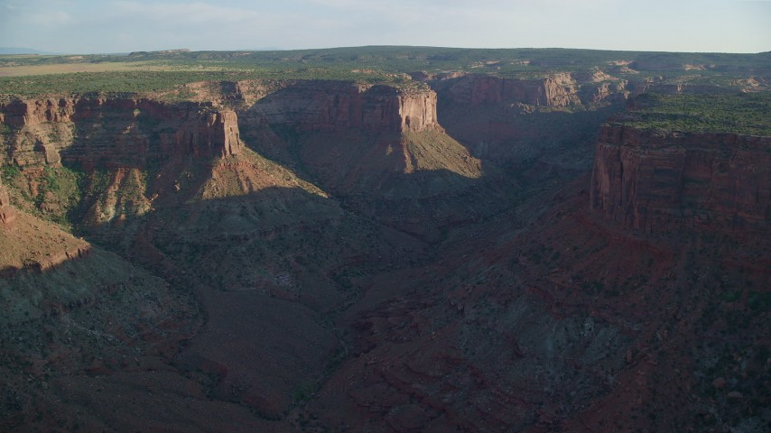 6K stock footage aerial video pan across a wide canyon with steep cliffs in Moab, Utah Aerial Stock Footage | AX138_208