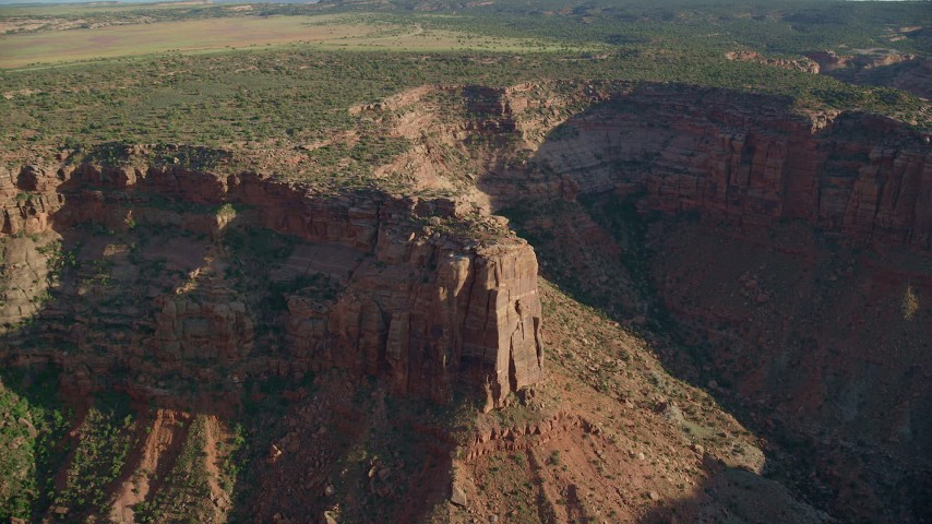 6K stock footage aerial video approach and tilt to canyon cliffs in Moab, Utah Aerial Stock Footage | AX138_210