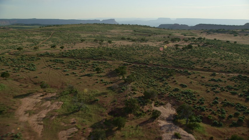 6K stock footage aerial video fly over desert and approach Hatch Point Road near Moab, Utah Aerial Stock Footage | AX138_227