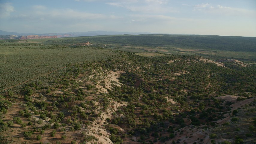6K stock footage aerial video of flying by shallow canyon seen from Hatch Point, Moab, Utah Aerial Stock Footage | AX138_239