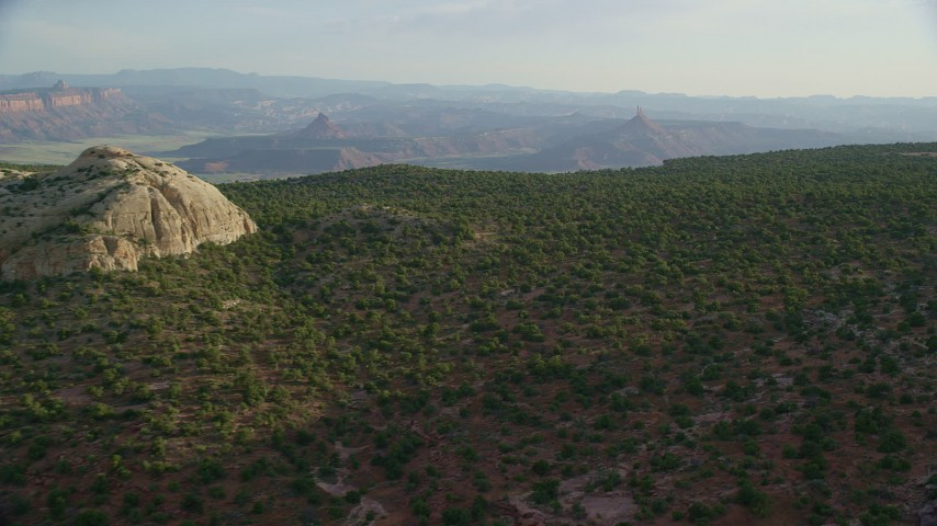 6K stock footage aerial video of flying by rock formation, tilt to desert plants, Moab, Utah Aerial Stock Footage | AX138_255